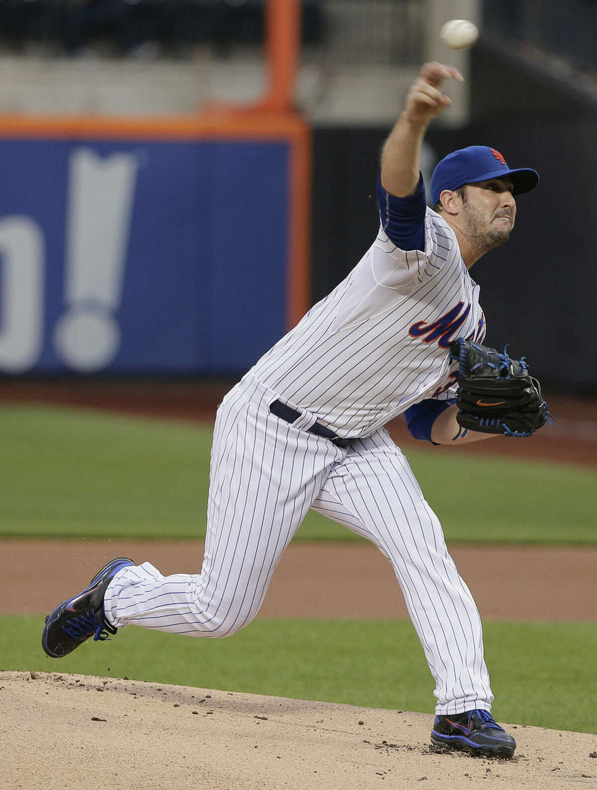 New York Mets pitcher Matt Harvey delivers to the Colorado Rockies during the first inning of a baseball game, Tuesday, Aug. 11, 2015, in New York. (AP Photo/Julie Jacobson)