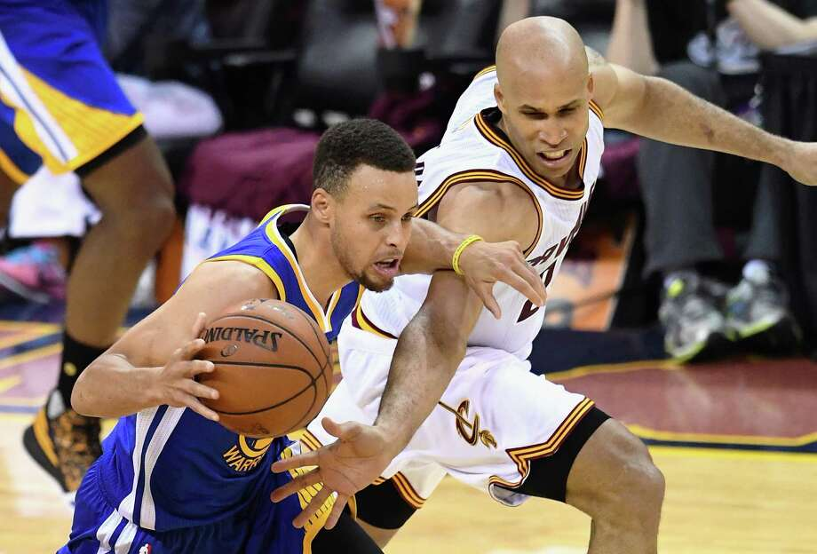 CLEVELAND, OH - JUNE 10:  Stephen Curry #30 of the Golden State Warriors handles the ball against Richard Jefferson #24 of the Cleveland Cavaliers during the second half in Game 4 of the 2016 NBA Finals at Quicken Loans Arena on June 10, 2016 in Cleveland, Ohio. NOTE TO USER: User expressly acknowledges and agrees that, by downloading and or using this photograph, User is consenting to the terms and conditions of the Getty Images License Agreement.  (Photo by Jason Miller/Getty Images) Photo: Jason Miller, Stringer / Getty Images / 2016 Getty Images