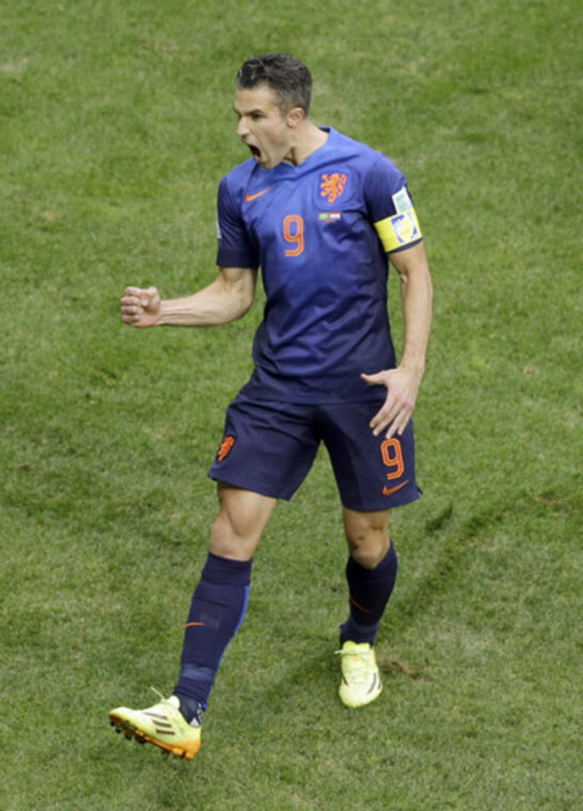 Netherlands' Robin van Persie celebrates after scoring a penalty during the World Cup third-place soccer match between Brazil and the Netherlands at the Estadio Nacional in Brasilia, Brazil, Saturday, July 12, 2014. (AP Photo/Themba Hadebe)