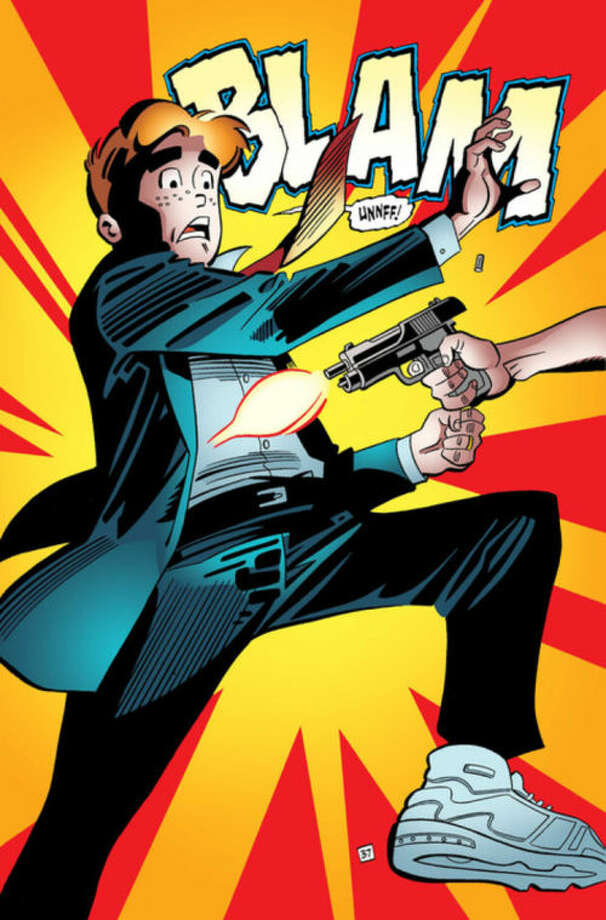 "This photo provided by Archie Comics shows Archie in his final moments of life in a scene from the comic book, ""Life with Archie,"" issue 36. Archie Andrews will die taking a bullet for his gay best friend. The famous freckle-faced comic book icon will die in the July 16, 2014 installment of ""Life with Archie"" while intervening in the assassination of Kevin Keller, Archie Comics' first openly gay character. (AP Photo/Archie Comics)"