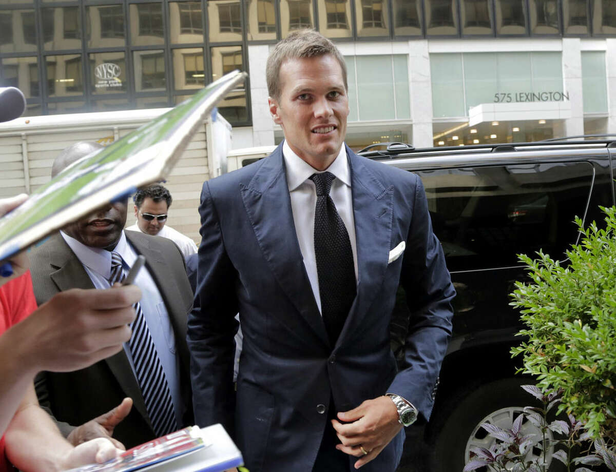 FILE - In this June 23, 2015, file photo, New England Patriot's quarterback Tom Brady arrives for his appeal hearing at NFL headquarters in New York. The NFL Players Union has sued to get a judge to void NFL Commissioner Roger Goodell's four-game suspension of Brady in the