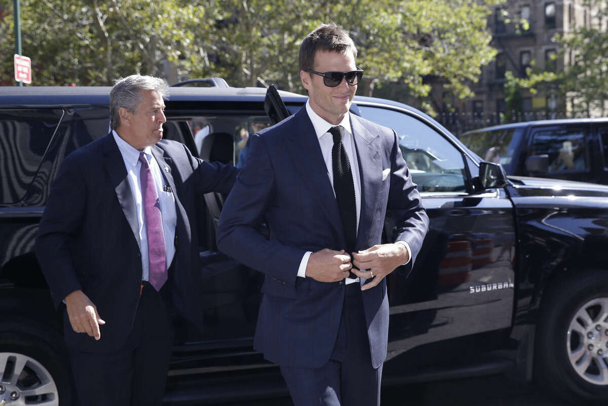 FILE - In this Aug. 12, 2015, file photo, New England Patriots quarterback Tom Brady arrives at federal court in New York. Tom Brady wasn't on the practice field with the New England Patriots on Tuesday, Aug. 18, 2015, a day before the court hearing for the NFL and the players' union. Both sides are due in federal court for the hearing Wednesday in New York with Judge Richard M. Berman over the quarterback's four-game suspension by NFL Commissioner Roger Goodell. (AP Photo/Mary Altaffer, File)