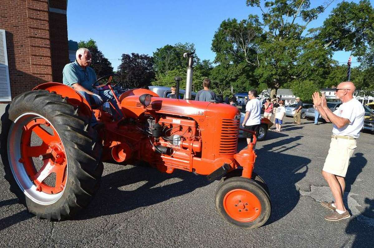 Hour Photo/Alex von Kleydorff Fred Baker pulls in with his completly restored 1944 Case Row Crop Tractor at the Wilton Kiwanis 14th annual Classic and Custom Car Show in Wilton Center Friday night.
