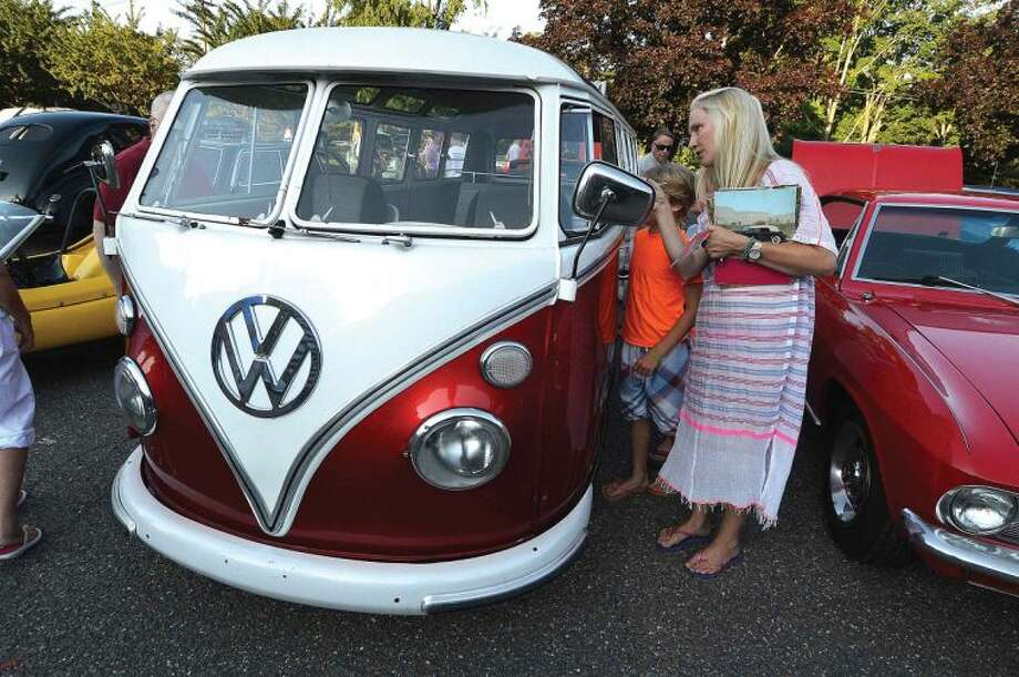 Hour Photo/Alex von Kleydorff Katie and Thomas Prendergast look inside an original 1966 21 Window Volkswagen Microbus in the Wilton Kiwanis 14th annual Classic and Custom Car Show in Wilton Center Friday night.