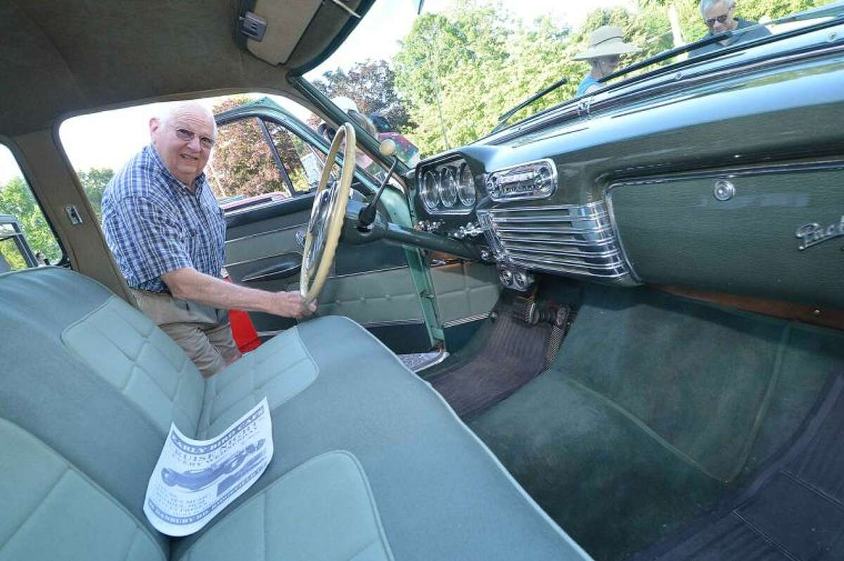 Hour Photo/Alex von Kleydorff Wilton's Sam Halsey shows the un touched original interior of his 1953 Packard Patrician at the Wilton Kiwanis 14th annual Classic and Custom Car Show in Wilton Center Friday night.