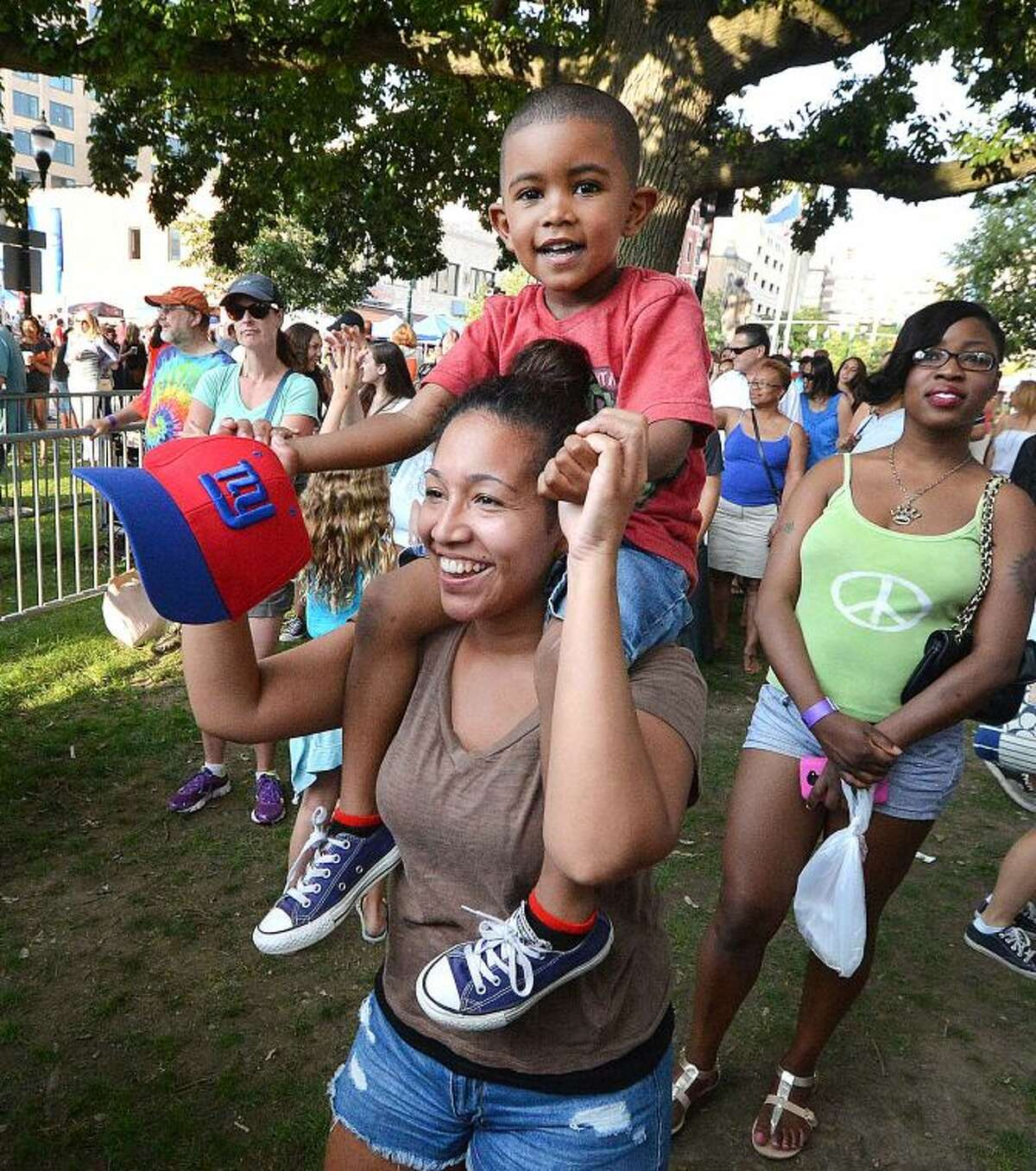 Hour Photo/Alex von Kleydorff Deanna Gomes dances with her 4 yr old nephew Steven Flores on her shoulders during Alive@Five in Stamford's Columbus Park on Thursday July 10th