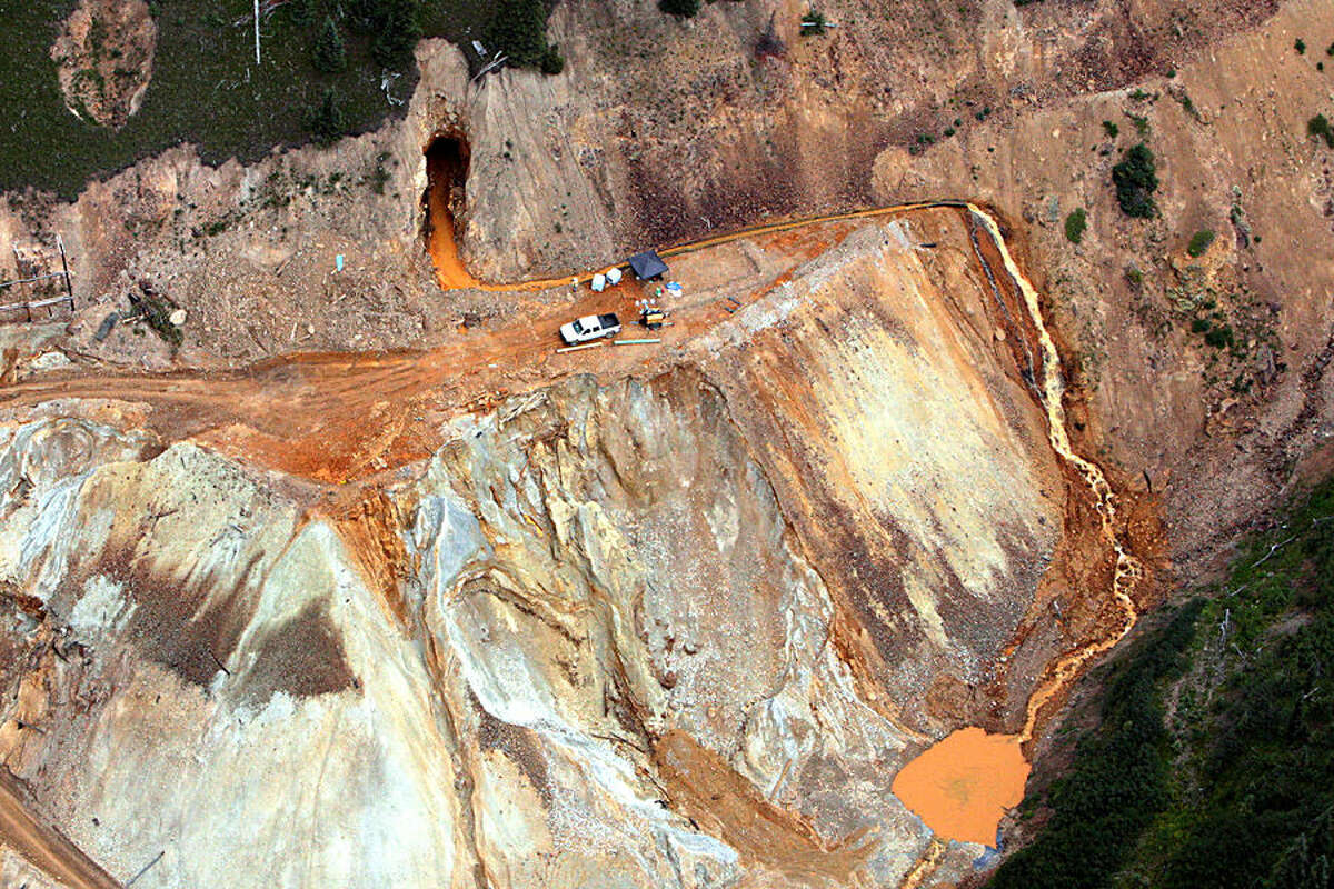 In this aerial photo taken Tuesday, Aug. 11, 2015, waste water continues to stream out of the Gold King Mine near Silverton, Colo. Frustration is mounting throughout the Four Corners region among officials and residents who say the EPA has moved too slowly and hasn't been forthcoming about the dangers of the spill. (Geoff Liesik/The Deseret News via AP) SALT LAKE TRIBUNE OUT; MAGS OUT; MANDATORY CREDIT MBO (REV-SHARE)