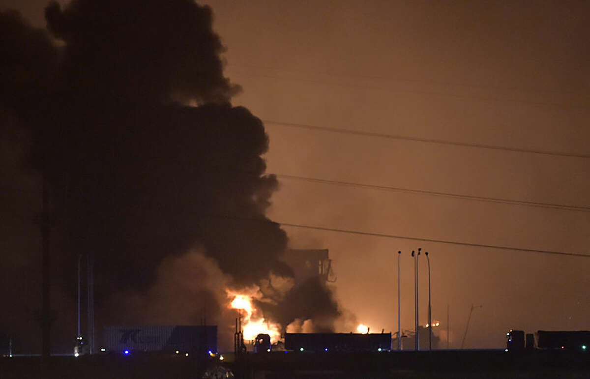 In this photo released by Xinhua News Agency smoke and fire rises after an explosion in the Binhai New Area in north China's Tianjin Municipality on Thursday Aug. 13, 2015. Chinese state media reported huge explosions at the Tianjin port late Wednesday. (Yue Yuewei/Xinhua via AP) NO SALES CHINA OUT