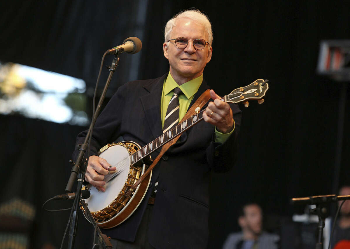 FILE - In this Oct. 20, 2012 file photo, Steve Martin performs at the Shoreline Amphitheatre in Mountain View, Calif. Martin will be honored by the International Bluegrass Music Association with a distinguished achievement award. The association announced special awards recipients and nominees on wednesday, Aug. 12, 2015, for the International Bluegrass Music Awards, which will be presented in Raleigh, N.C., on Oct. 1. (Photo by Barry Brecheisen/Invision/AP, File)