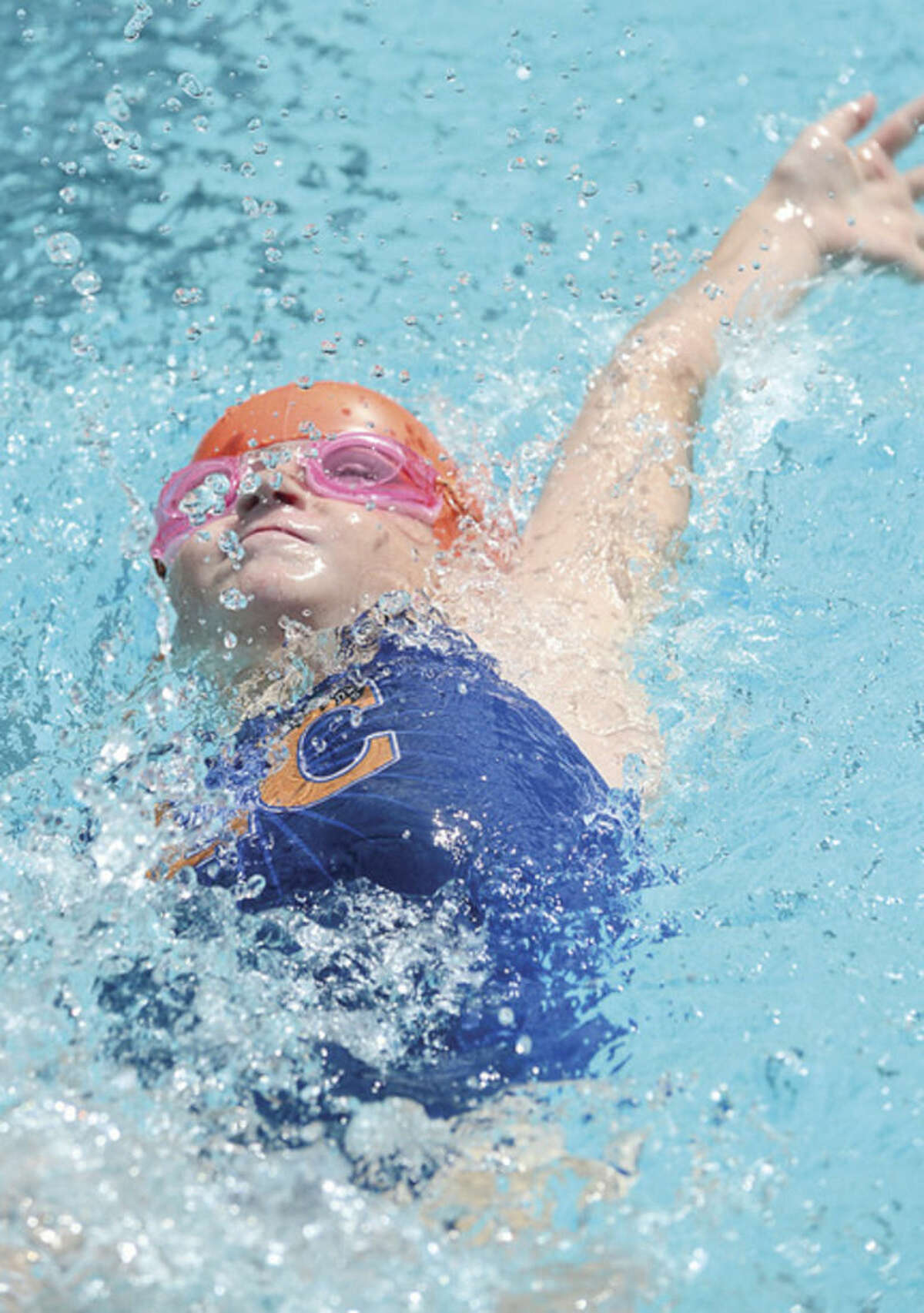 Photo by Erik Trautmann Phoebe Snow swims in the 10-and-under 25-meter backstroke for the Lake Club during the Fairfield County Swim League championship meet at Roxbury Country Club on Saturday, Aug. 8, in Stamford. Snow placed 10th in the event with a time of 24.03, thereby helping Lake Club place 10th as a team overall.