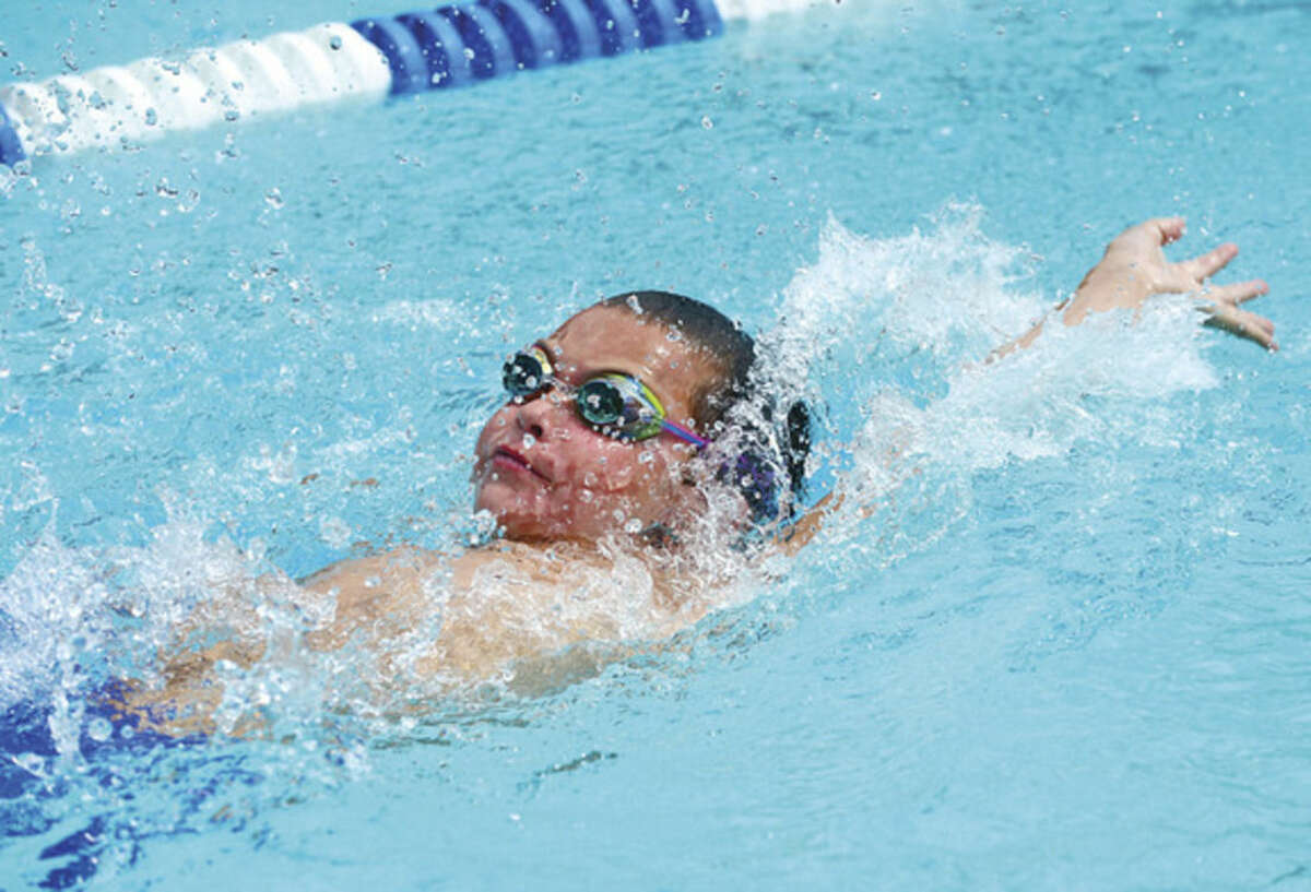 Photo by Erik Trautmann Justin Lewis swims the 10-and-under 25-meter backstroke for the Lake Club during the Fairfield County Swim League Championship meet on Saturday, Aug. 8, at Roxbury Country Club in Stamford. Lewis took 12th in the event as Lake Club finished in second place.