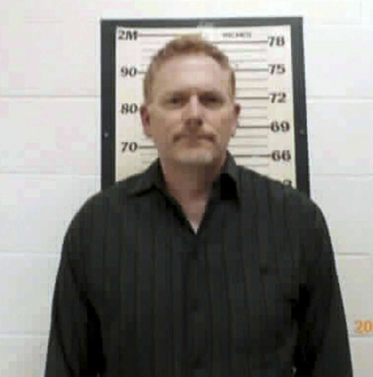 In this Sunday, July 13, 2014 photo released by the Wayne County Sheriff, Randall Miller poses for a photo. ?