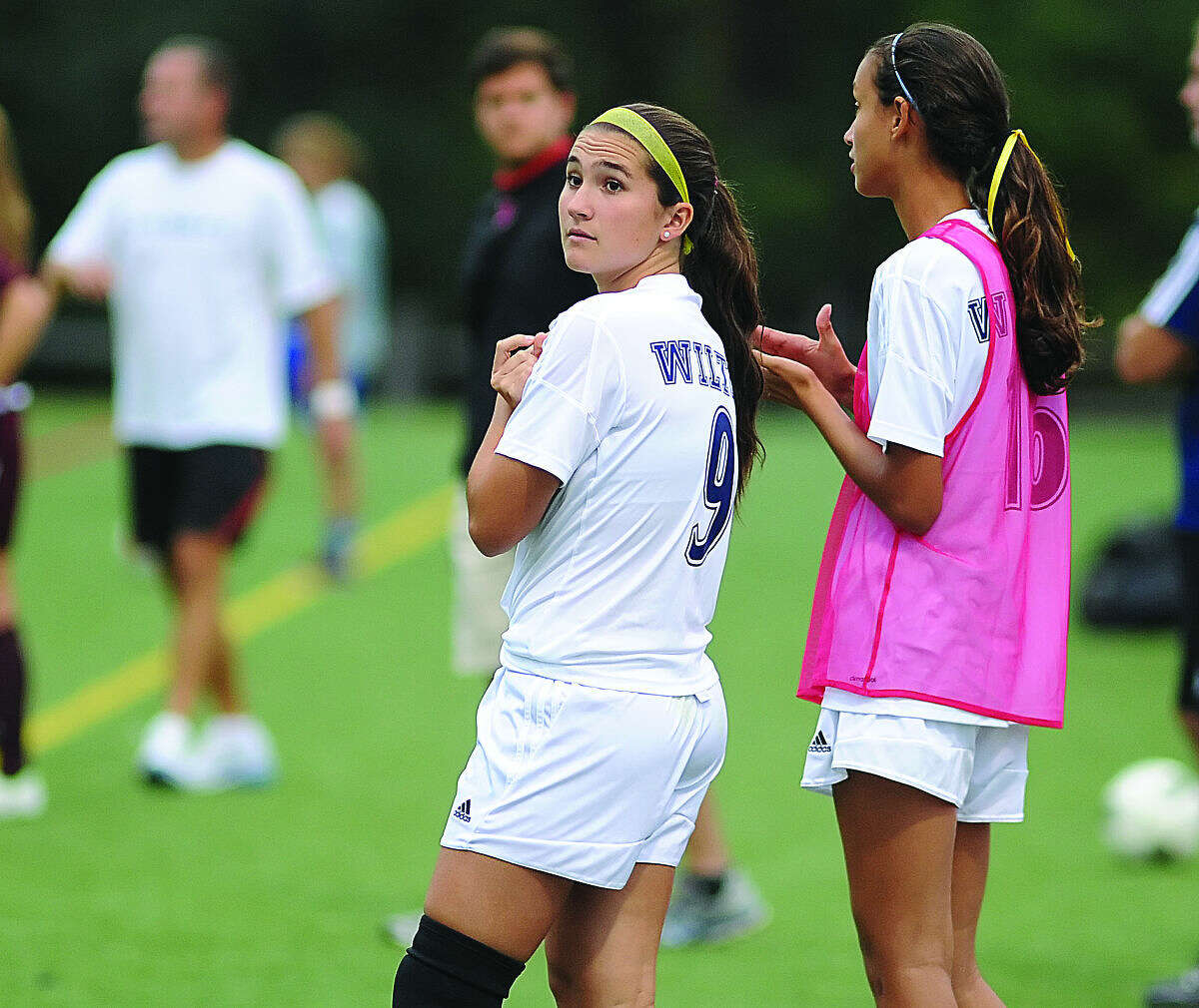 File photo by John nash - Former Wilton High soccer standout Jayne Maccio looks toward the clock as time ticks down during a 2-2 tie with St. Joseph last fall at Kristine Lilly Field in Wilton. Despite missing her junior and senior years due to knee injuries, Maccio has taken her talents to the Division 1 soccer tanks this fall.
