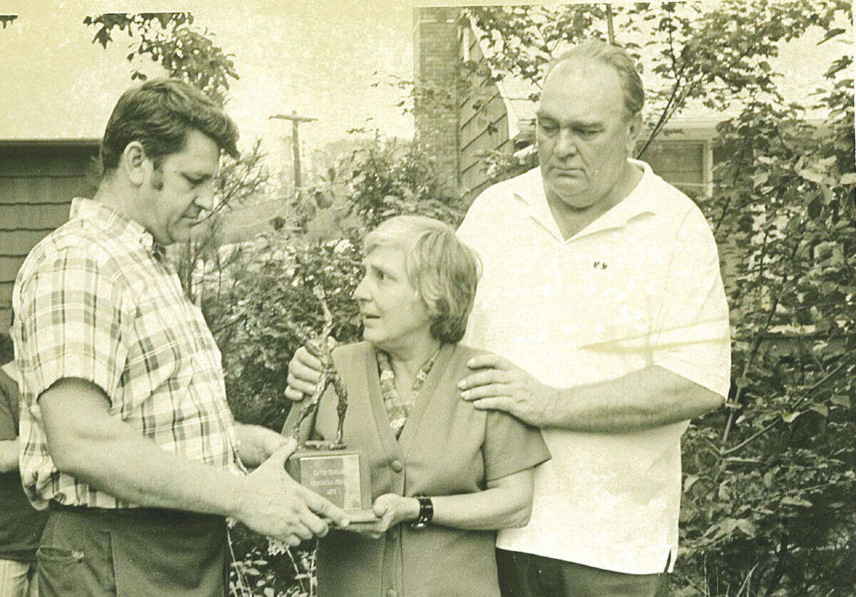 Martha Kinlock (center) and her husband Raymond Kinlock (right) receive the original David Kinlock Sportsmanship Trophy in 1971 from Joe Marchese, who was Kinlock's coach in the International Little League. Contributed Photo