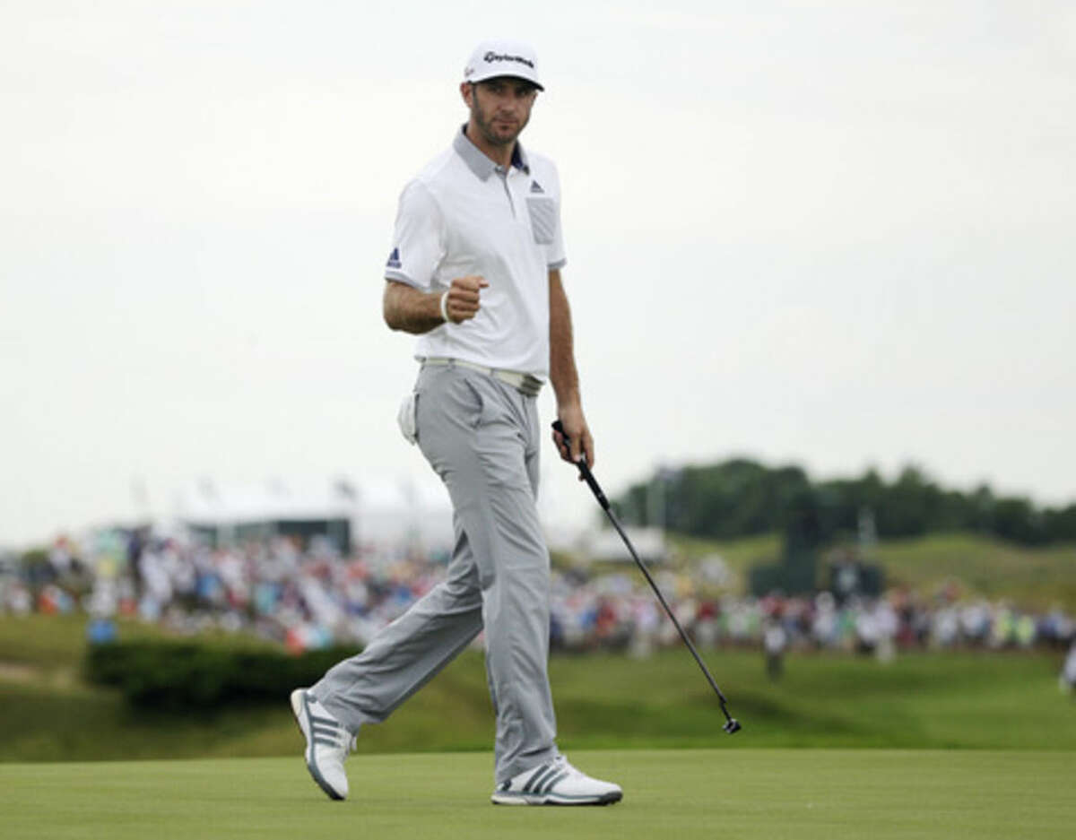 Dustin Johnson reacts after making an eagle putt on the 16th hole during the first round of the PGA Championship golf tournament Thursday, Aug. 13, 2015, at Whistling Straits in Haven, Wis. (AP Photo/Jae Hong)