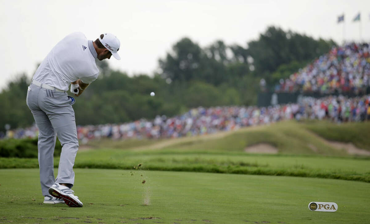 Dustin Johnson hits a tee shot on the 17th hole during the first round of the PGA Championship golf tournament Thursday, Aug. 13, 2015, at Whistling Straits in Haven, Wis. (AP Photo/Jae Hong)
