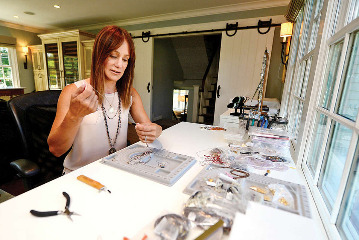 Hour photo / Erik Trautmann Westport resident Phylis Kurzer has created a jewelry company called Karma Mala, which donates 100 percent of its proceeds to a project called,
