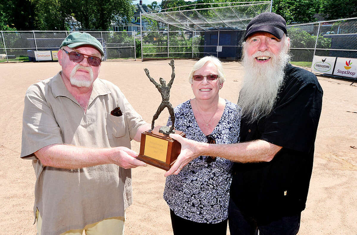 Hour photo / Erik Trautmann Einar, Karen and Raymond Kinlock, brothers and sister of the late David Kinlock, whose memory is honored every summer with the David Kinlock Memorial Youth Baseball Tournament.