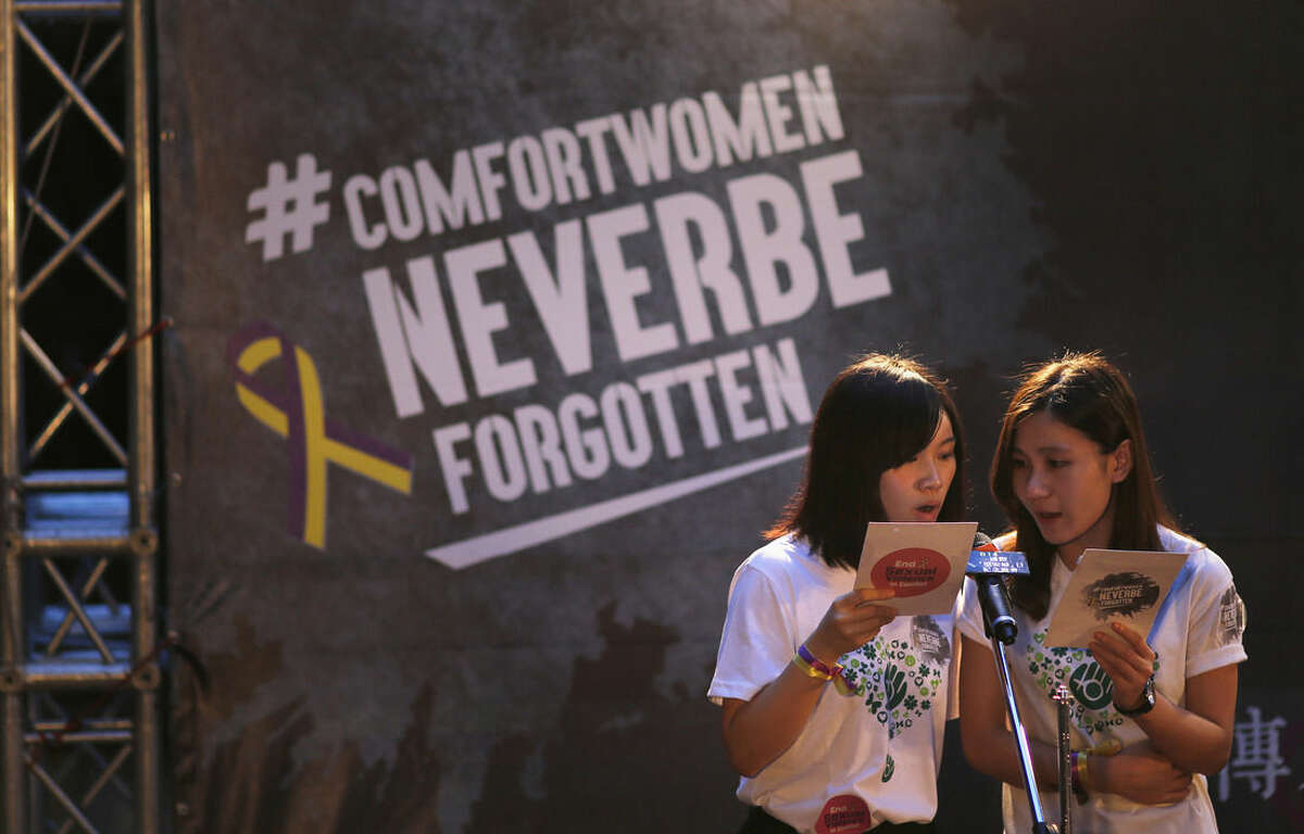 Two women give a speech during a memorial for Taiwan's