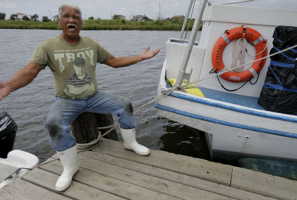 ADVANCE FOR USE FRIDAY, AUG. 14, 2015 AND THEREAFTER - Raymond Reyes, a lifelong resident of Grand Bayou, La., speaks about his shrinking fishing community, Tuesday, Aug. 4, 2015. The 71-year-old says,