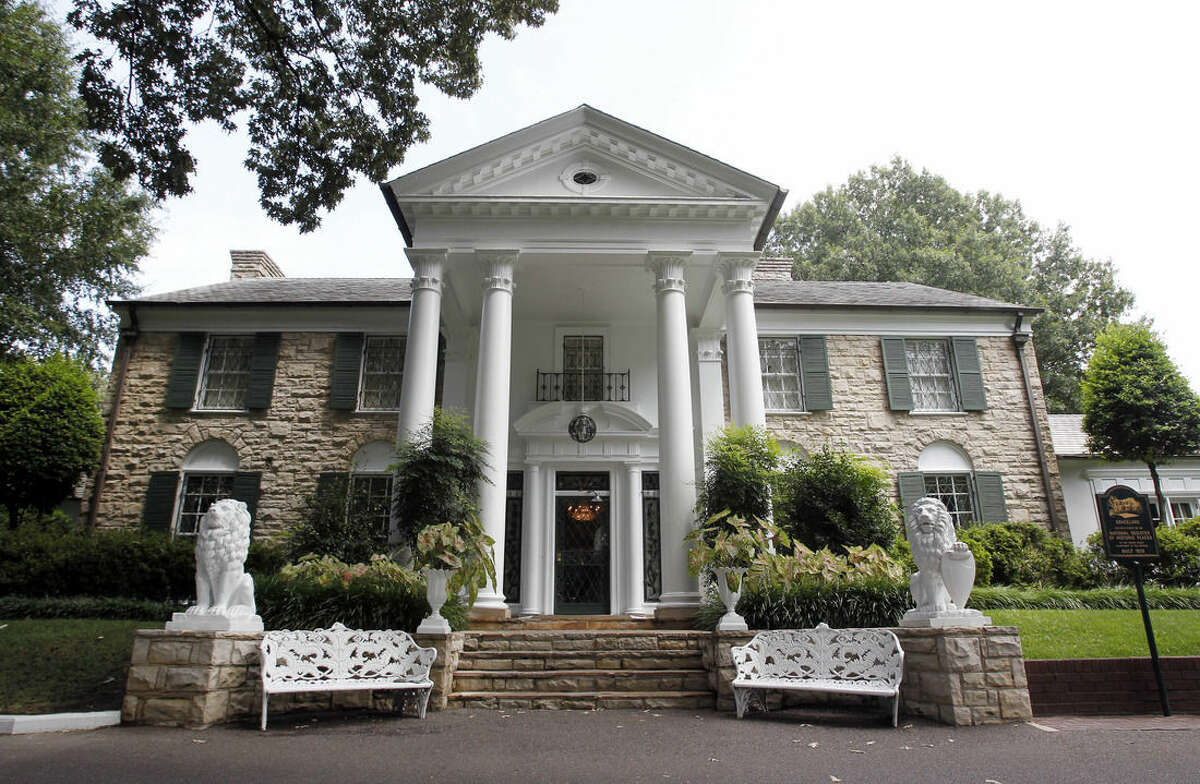 FILE - This August 2010 file photo, shows Graceland, Elvis Presley's home in Memphis, Tenn. Over a hundred authenticated artifacts are up for auction Thursday, Aug. 13, 2015, as part of Elvis Week at Graceland. (AP Photo/Mark Humphrey, File)