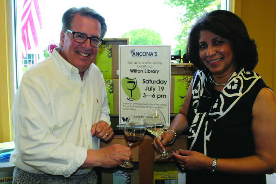 Michael Crystal will be hosting a wine tasting by Ancona's Wines & Liquors. He is pictured with Elaine Tai-Lauria, executive director of Wilton Library, which will benefit from proceeds at the event. Acona's wine tasting event will be on Saturday, July 19, from 3-6 p.m.