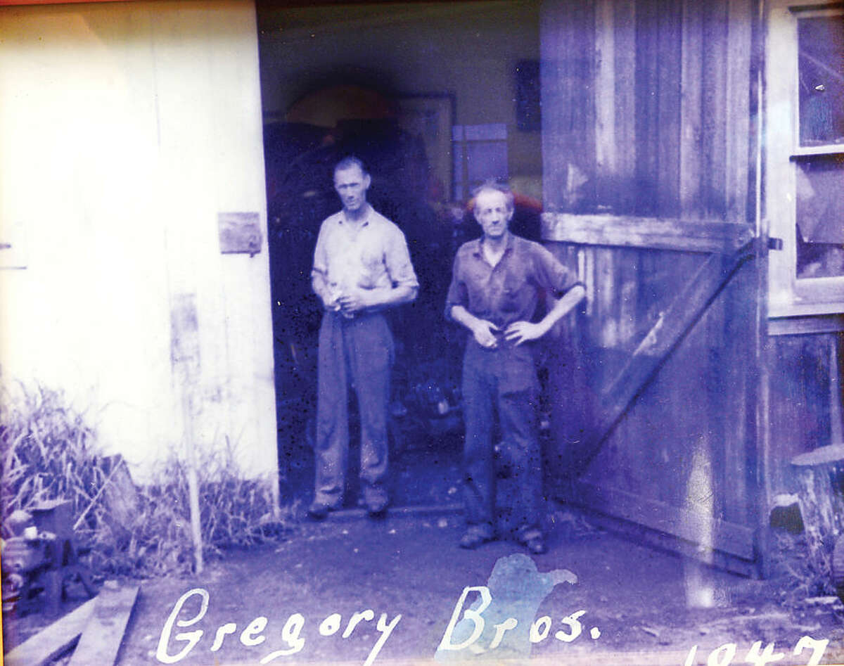 Hour photo / Erik Trautmann David Gregory and Fred Gregory, grandfather and great uncle of Taber Gregory, owner of Gregory Sawmill in Wilton which has been in his family for over 100 years.