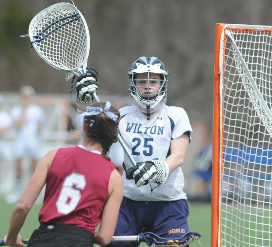 Hour photo/John Nash - Wilton's Hannah Wiltshire is The Hour's All-Area MVP for girls lacrosse for 2014.