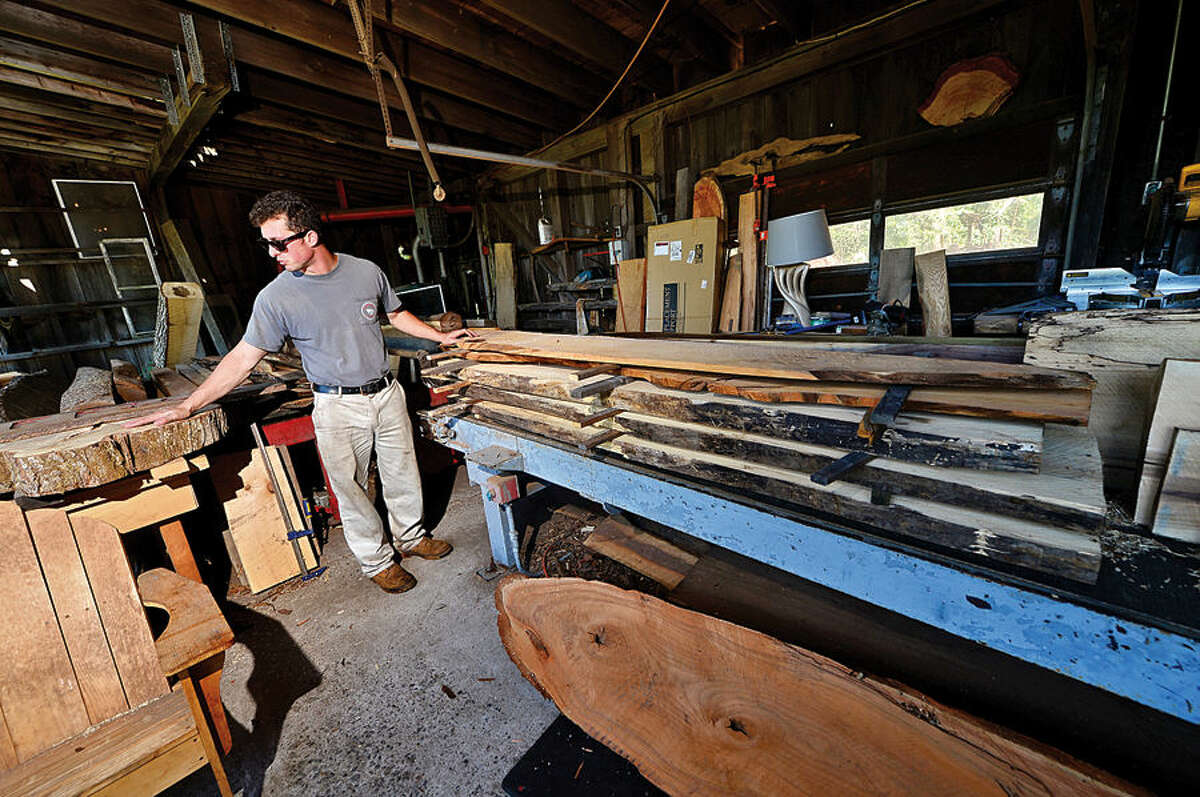 Hour photo / Erik Trautmann Gregory Sawmill employee Carl Strate displays milled wood at the Wilton sawmill which has been in operation for over 100 years.