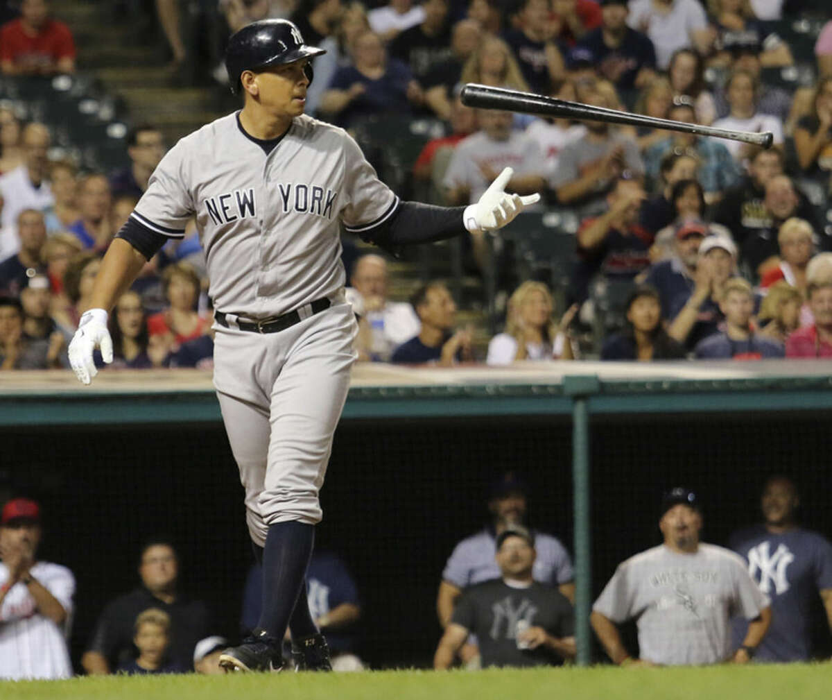 New York Yankees Alex Rodriguez flips his bat fter striking out during the eighth inning of a baseball game against the Cleveland Indians on Thursday, Aug. 13, 2015, 2015, in Cleveland. (AP Photo/Aaron Josefczyk)
