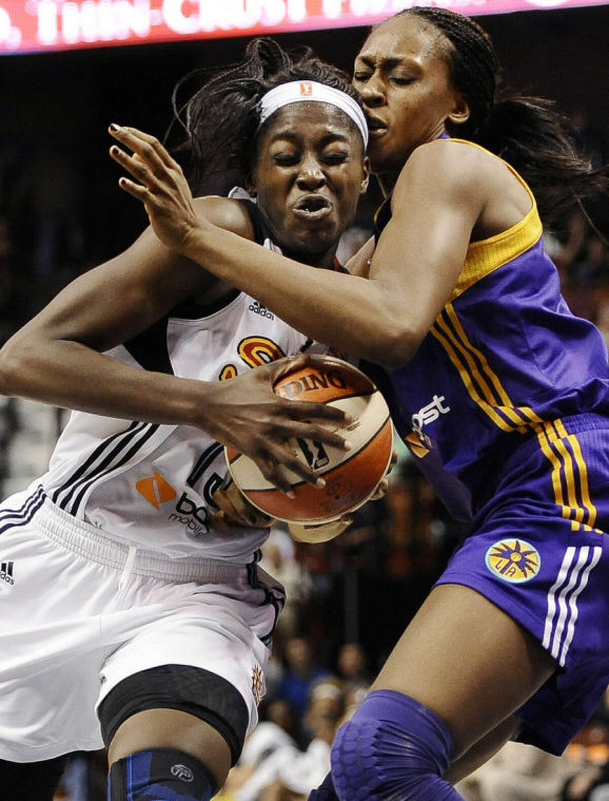 Connecticut Sun?'s Chiney Ogwumike, left, is guarded by Los Angeles Sparks?' Sandrine Gruda, right, during the second half of a WNBA basketball game, Sunday, July 13, 2014, in Uncasville, Conn. The Sparks won 90-64. (AP Photo/Jessica Hill)