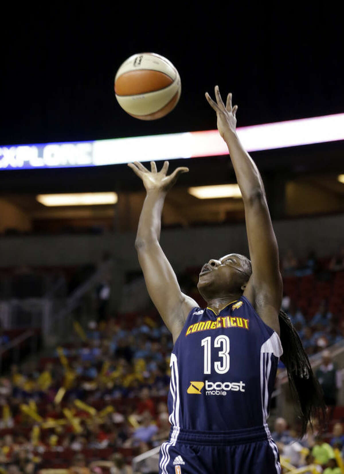 Connecticut Sun's Chiney Ogwumike grabs a rebound against the Seattle Storm during the first half of a WNBA basketball game Tuesday, July 15, 2014, in Seattle. (AP Photo/Elaine Thompson)