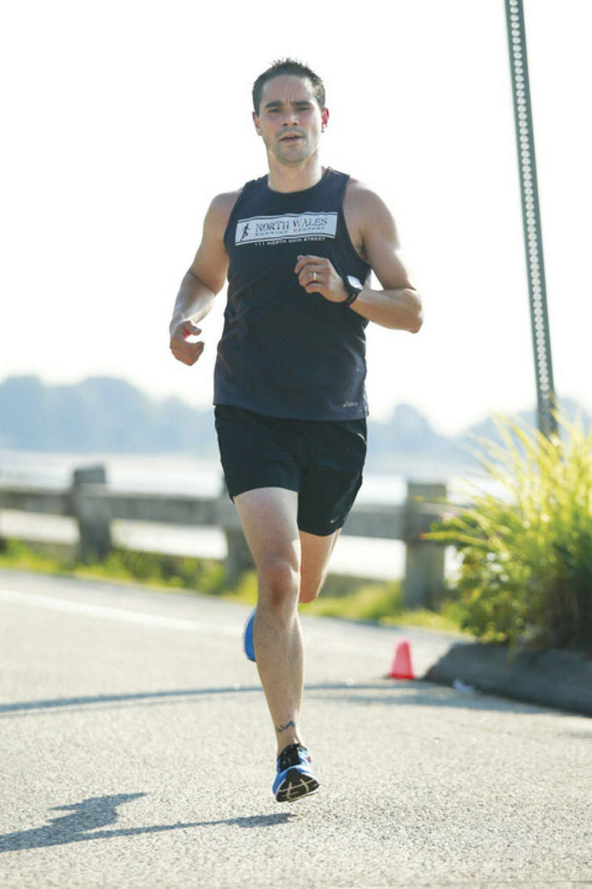Hour photo/Chris Palermo James Osborne finishes first overall during the Westport Road Runners race Saturday morning at Compo Beach.