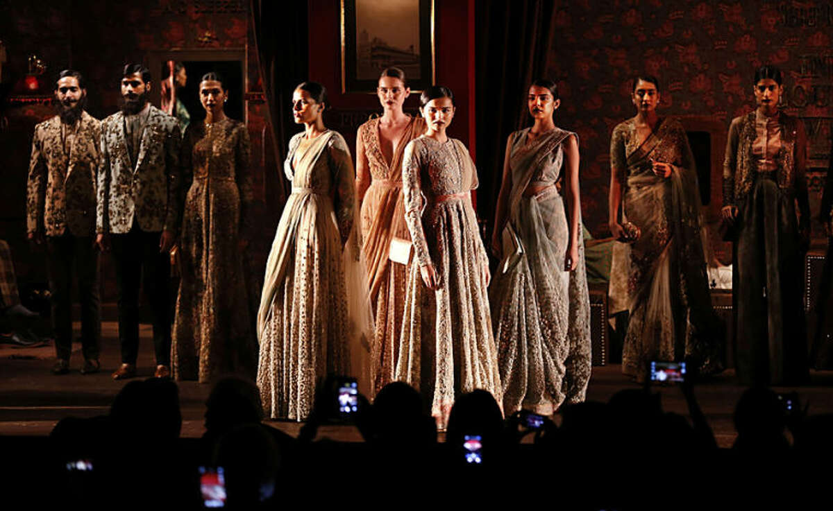 Models pose after displaying clothes designed by Indian designer Sabyasachi at the India Couture Week, held by the Fashion Design Council of India, in New Delhi, India, Tuesday, July 15, 2014. (AP Photo/Saurabh Das)