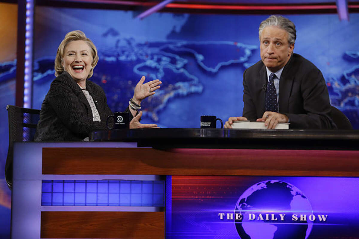 Former U.S. Secretary of State Hillary Rodham Clinton reacts to host Jon Stewart during a taping of