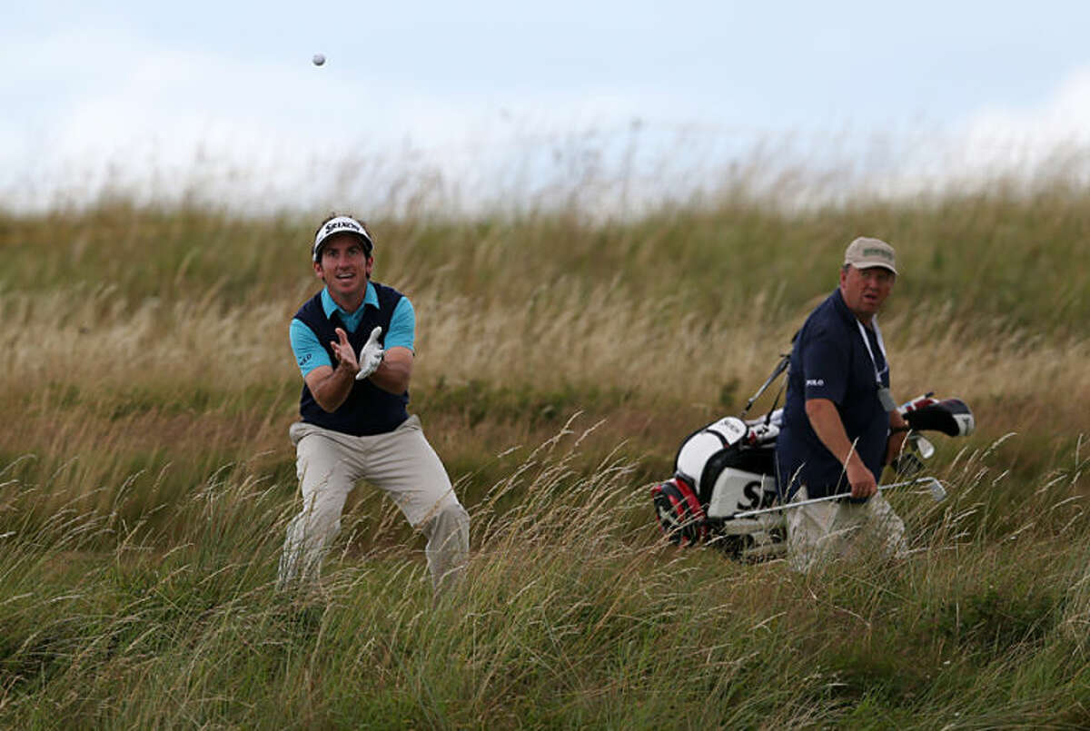 Gonzalo Fernandez-Castano of Spain catches a ball as he walks along the 4th hole during a practice round ahead of the British Open Golf championship at the Royal Liverpool golf club, Hoylake, England, Wednesday July 16, 2014. The British Open Golf championship starts Thursday July 17. (AP Photo/Jon Super)