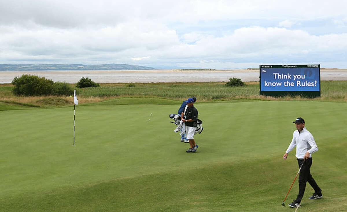 Martin Kaymer of Germany walks onto the 13th green during a practice round ahead of the British Open Golf championship at the Royal Liverpool golf club, Hoylake, England, Wednesday July 16, 2014. The British Open Golf championship starts Thursday July 17. (AP Photo/Jon Super)