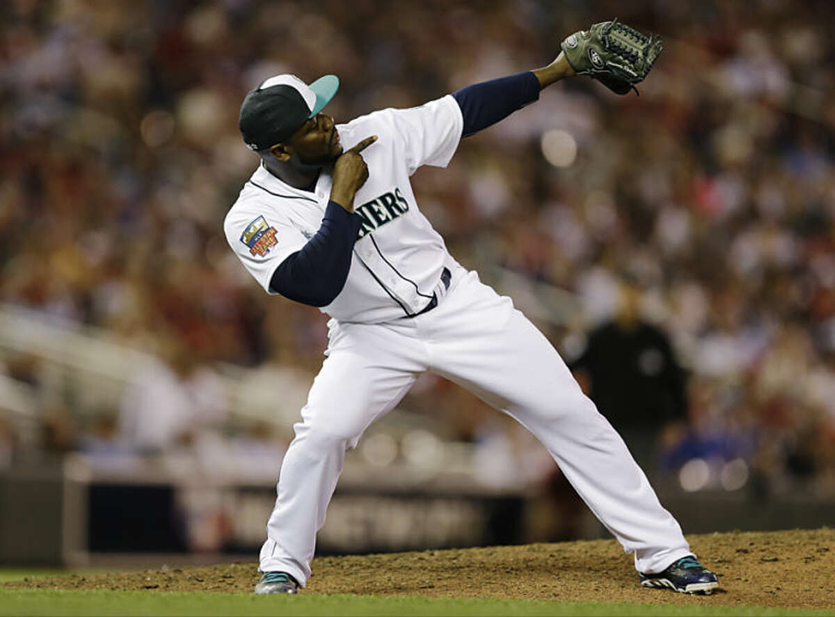 American League pitcher Fernando Rodney, of the Seattle Mariners, reacts after striking out National League's Daniel Murphy, of the New York Mets, to end the eighth inning of the MLB All-Star baseball game, Tuesday, July 15, 2014, in Minneapolis. (AP Photo/Jeff Roberson)