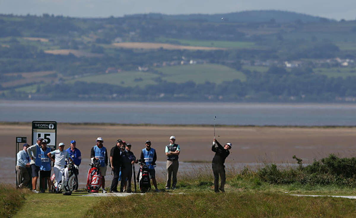 Phil Mickelson of the US plays off the 15th tee during a practice round ahead of the British Open Golf championship at the Royal Liverpool golf club, Hoylake, England, Tuesday July 15, 2014. The British Open golf championship starts on Thursday July 17. (AP Photo/Jon Super)