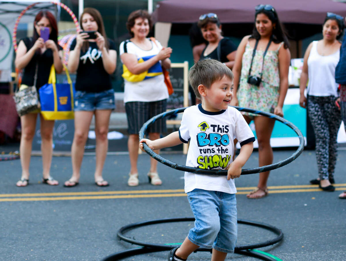 Hour photo/Chris Palermo. Darrin St. Amand, 4, hulahoops for a crowd at the SONO Arts Festival Saturday afternoon.