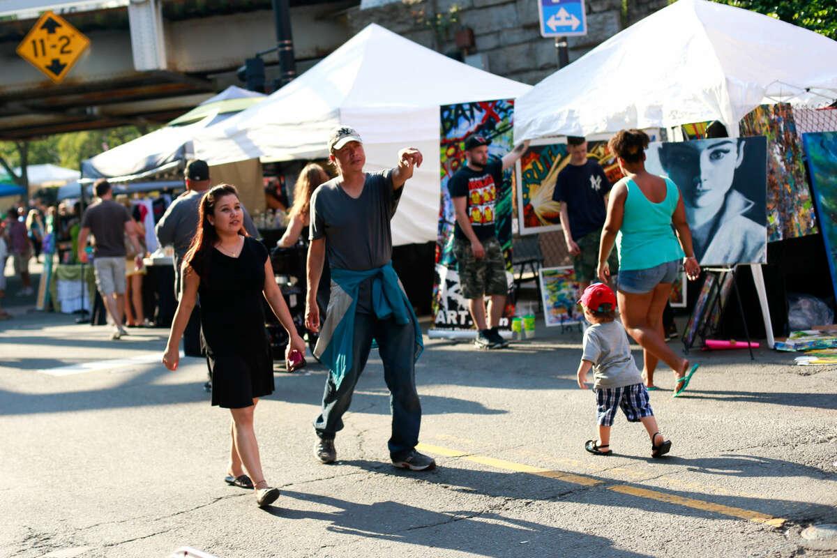 Hour photo/Chris Palermo. Festival goers walk down Washington Street at the SONO Arts Festival Saturday afternoon.