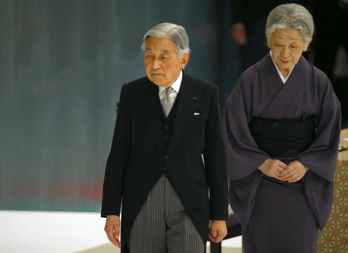 Japan's Emperor Akihito, accompanied by Empress Michiko, leaves after delivering his remarks during a memorial service at Nippon Budokan martial arts hall in Tokyo, Saturday, Aug. 15, 2015. Japan marked Saturday the 70th anniversary of the end of World War II. (AP Photo/Shizuo Kambayashi)
