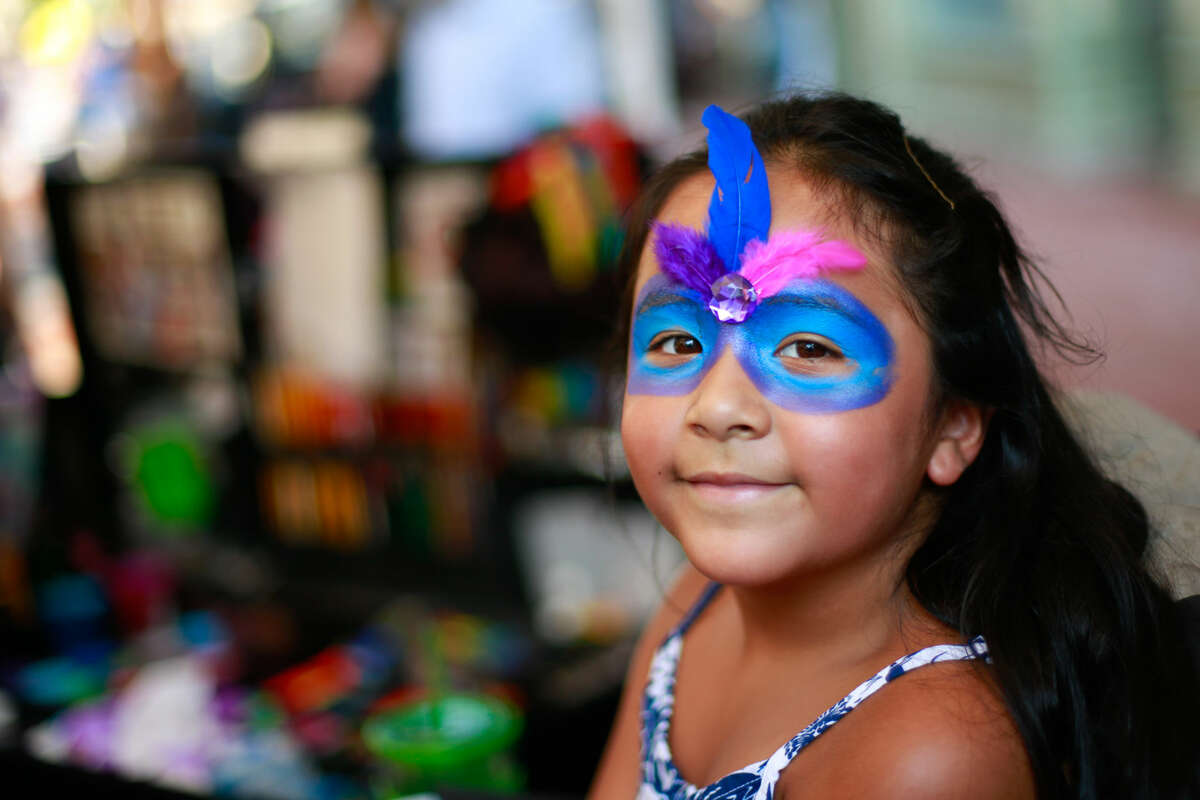 Hour photo/Chris Palermo. Tatiana Gonzalez, 7, gets her face painted at the