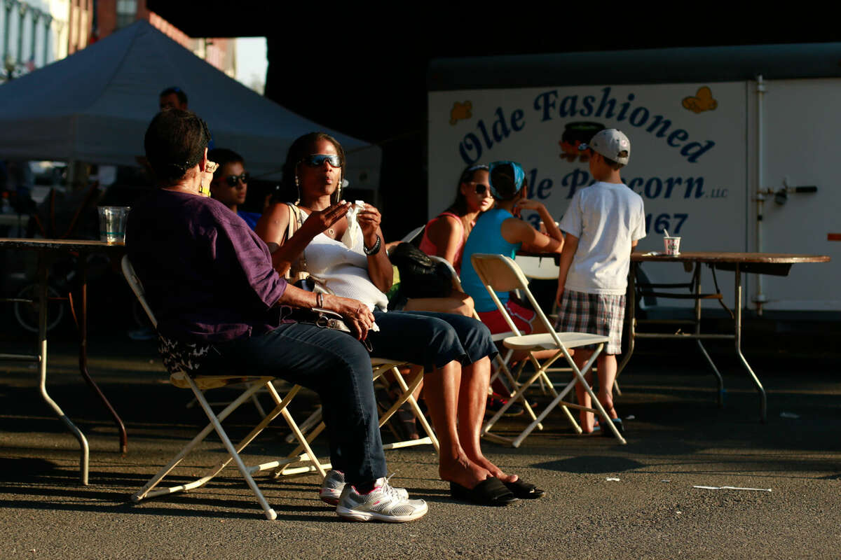 Hour photo/Chris Palermo. Festival goes enjoys relax and enjoy the sunlight at the SONO Arts Festival Saturday afternoon.
