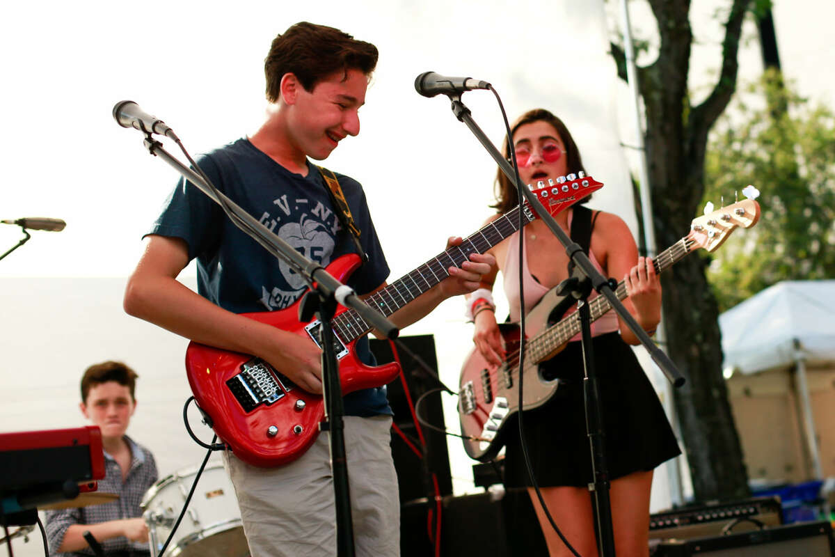 Hour photo/Chris Palermo. Fairfield School of Rock students perform at the SONO Arts Festival Saturday afternoon.