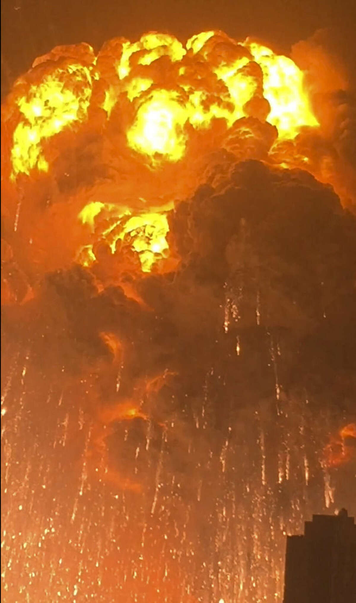 In this Wednesday, Aug. 12, 2015, image taken from video provided by Dan Van Duren a warehouse explodes in Tianjin, China, as filmed from a nearby residential building. Tianjin is the world's 10th largest port. (Dan Van Duren via AP) MANDATORY CREDIT