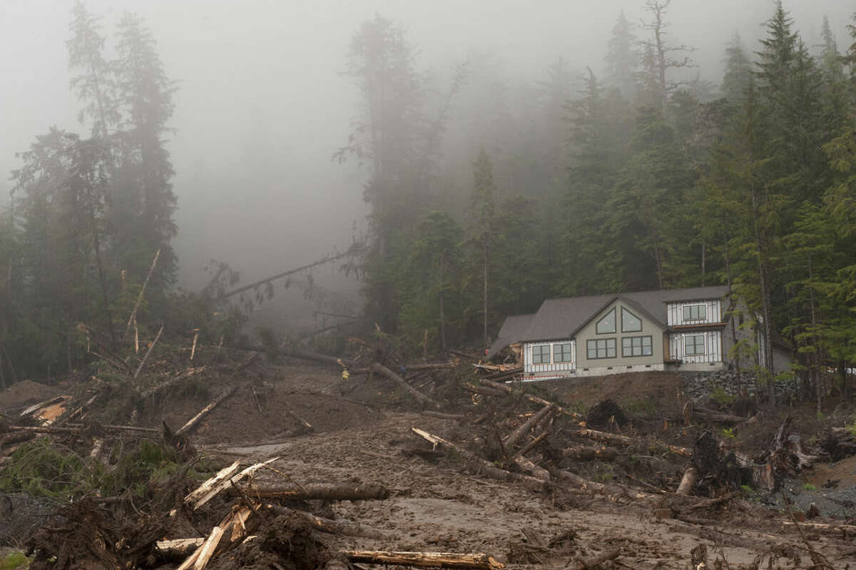 A house under construction sits next to a landslide Tuesday, Aug. 18, 2015, in Sitka, Alaska. Homes in the town have been flooded, and there were reports of residents not being able to reach their homes or leave their neighborhood, said a spokesman for the state Department of Homeland Security and Emergency Management. (James Poulson/The Daily Sitka Sentinel via AP) MANDATORY CREDIT