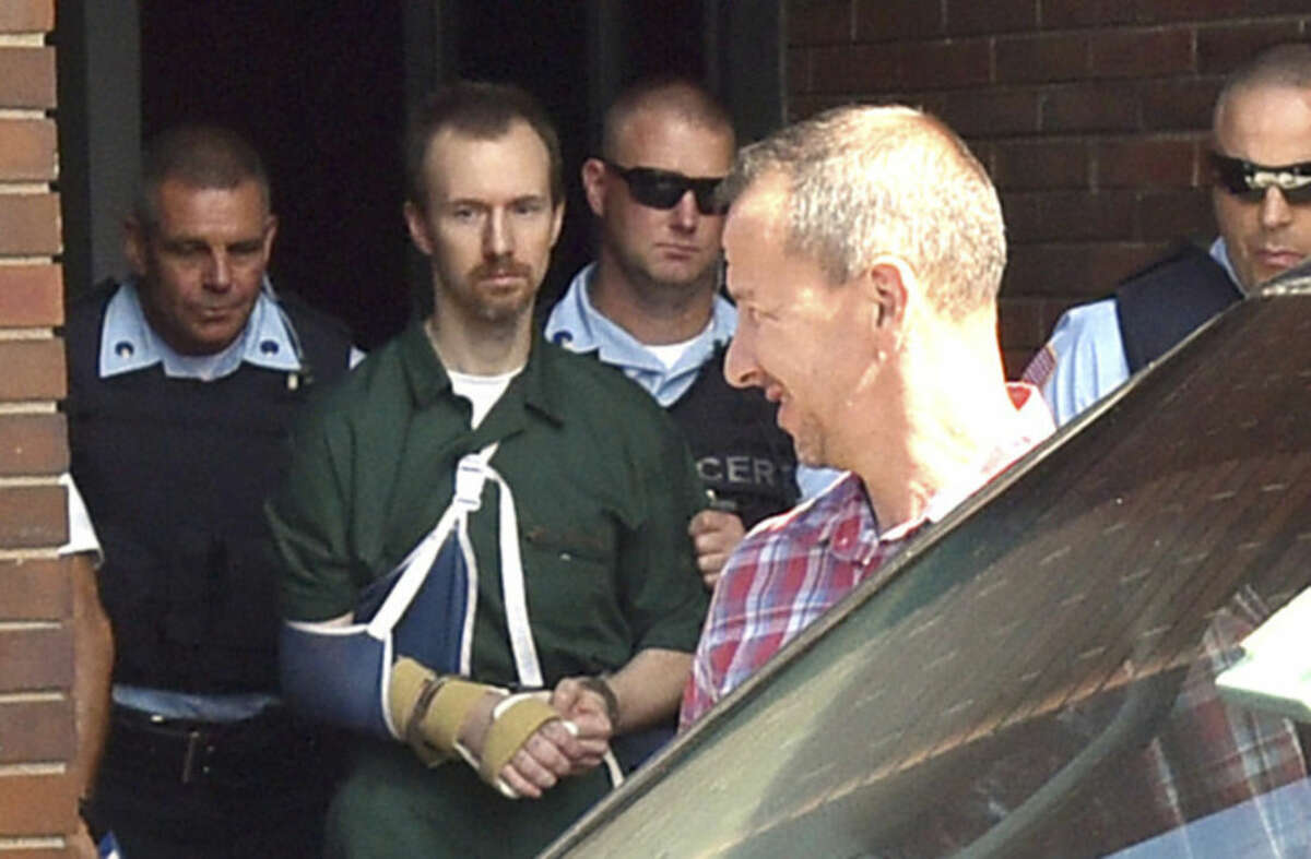 David Sweat, second from left, is lead into Clinton County Court Thursday, Aug.20, 2015 in Plattsburgh, N.Y. Sweat, a convicted killer who escaped June 6 from the Clinton Correctional Facility and spent more than three weeks on the run was arraigned Thursday on criminal charges stemming from the breakout. Sweat pleaded not guilty to first-degree escape and promoting prison contraband. He is due back in court on September 29. (Rob Fountain/Press-Republican via AP) MANDATORY CREDIT