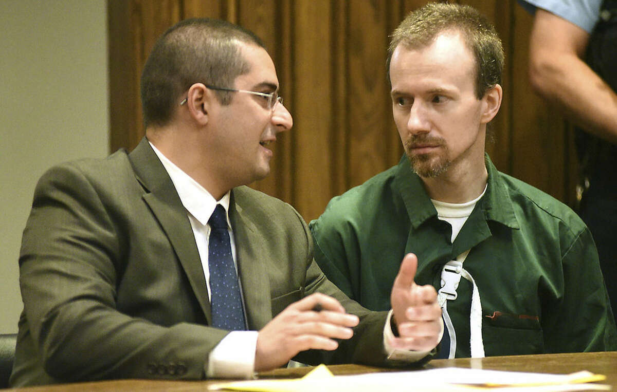 David Sweat, right, talks with his lawyer, Joseph Mucia before his court hearing Thursday Aug. 20, 2015 at Clinton County Court in Plattsburgh, N.Y. Sweat, a convicted killer who escaped June 6 from the Clinton Correctional Facility and spent more than three weeks on the run was arraigned Thursday on criminal charges stemming from the breakout. Sweat pleaded not guilty to first-degree escape and promoting prison contraband. He is due back in court on September 29. (Rob Fountain/Press-Republican via AP) MANDATORY CREDIT