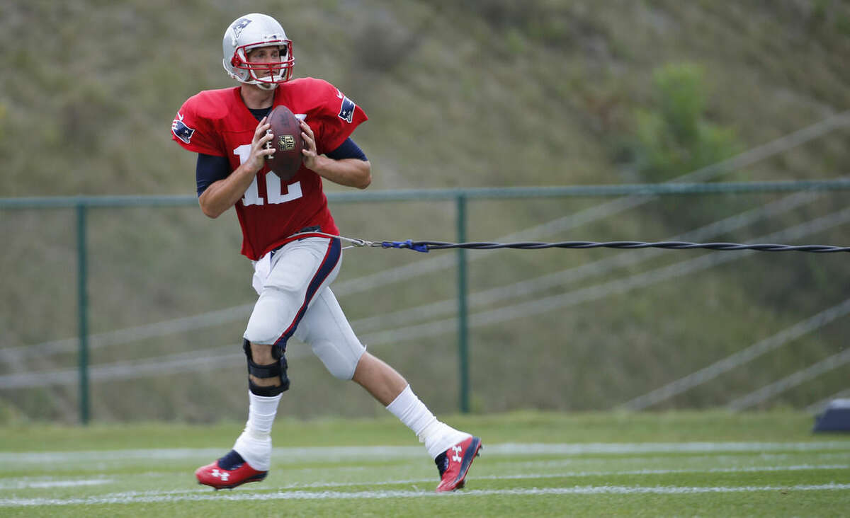 New England Patriots quarterback Tom Brady (12) runs a drill during a joint practice between the Patriots and New Orleans Saints at the Saint's NFL football training camp in White Sulphur Springs, W.Va., Thursday, Aug. 20, 2015. (AP Photo/Steve Helber)